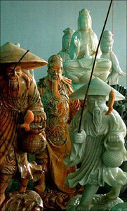Marble fishermen, Danang, Vietnam - You never know where you'll find a good travel picture. Near Danang, on the road to Hue, we stopped at a store selling sculpture to tourists. I saw this particular grouping of figures, noticed the play of natural window light and the variation of colors, and made a tight vertical shot that animates the marble characters.