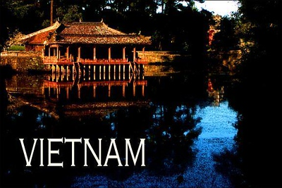 Imperial Pavillion, Hue, Vietnam - This wooden structure is over 200 years old. The Vietnamese emperors used it as a lakeside retreat. I photographed it in late afternoon, and took particular care to place it at the top of the frame, so that the bulk of the picture would be filled with reflections of both the building and the deep blue sky.