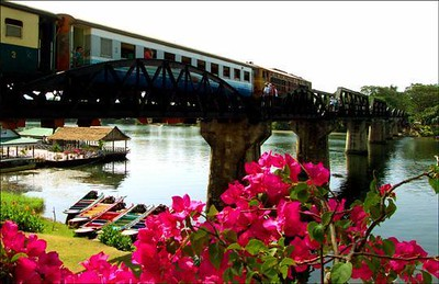 Bridge over the River Kwai, Thailand - On this site stood one of the most terrible prison camps of World War II. I thought these flowers offered a vital contrast to the sad memories of those times.