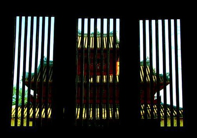 The Forbidden City, Hue, Vietnam - To me, the Forbidden City was once a place hard to enter, and perhaps even more difficult to leave. I try to make this point by shooting one of its palaces through the shutters of another.