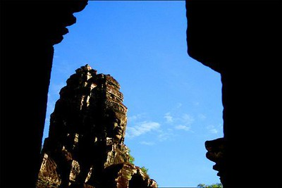 The Bayon, Angkor Thom, Cambodia - The Bayon is a great 12th Century Khmer temple complex near Angkor Wat. It has many towers, all of them covered with huge faces. I chose only one of them to photograph, and framed it in the doorway of the temple to draw the eye.