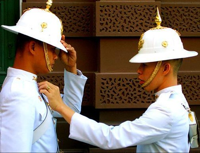 Changing of the Guard, Bangkok, Thailand - A telephoto lens was used to come in close on the faces and hands on these Thai soldiers, as they spruce themselves up.