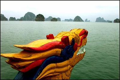Dragonscape, Halong Bay, Vietnam - Our day at Halong Bay was overcast, making color photography difficult at best. By emphasizing the decorative dragon on the bow of our boat in this wideangle shot, I was able to contrast the misty islands rising out of the bay with a splash of rich colors.