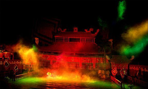 Water puppet show, Hanoi, Vietnam - Not to be missed in Hanoi, is a charming water puppet show featuring dazzling special effects. I photographed this explosive scene without flash. I was amazed at this digital cameras ability to record hand-held scenes in very dark places.