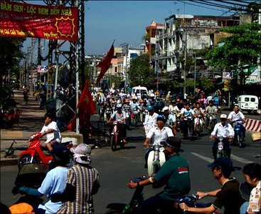 Ho Chi Minh City traffic, Vietnam - Vietnam is a country on wheels. Nearly everyone seems to ride motorbikes. There are few traffic regulations and the roar never ceases. Here, a typical urban intersection at midmorning.