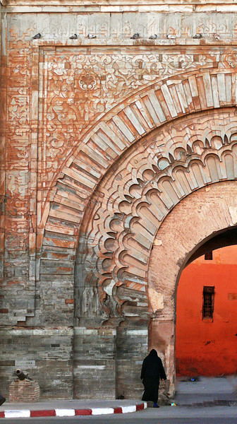 Bab Agnaou, Marrakesh - The most beautiful gate in the ramparts of Marrakesh, this 900 year old arch once led to the Royal Palace. Its carved sandstone still shows tinges of red, melding with grayish blue. The sculpted facade consists of alternating layers of stone and brick.