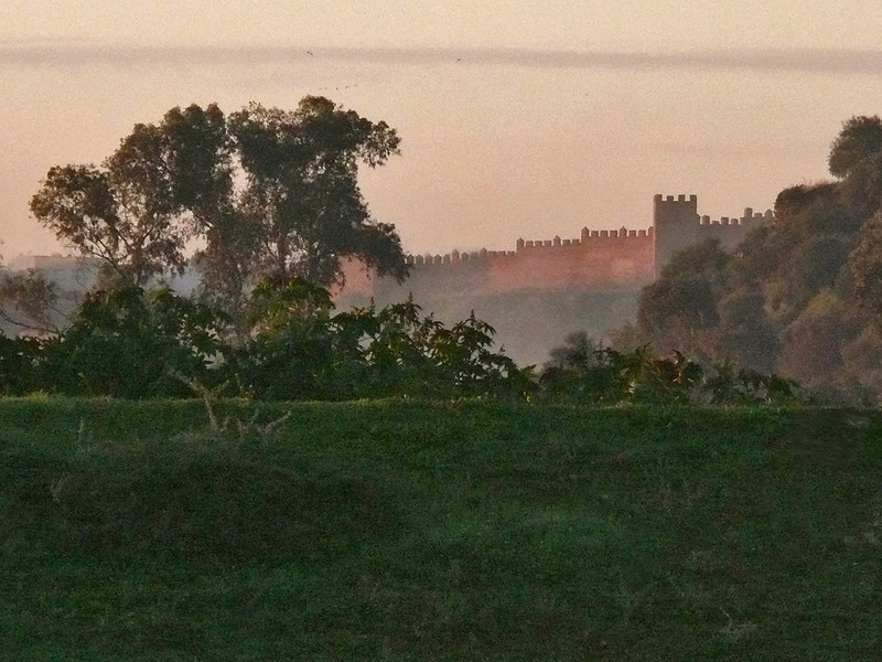 Walls of Rabat at dawn - These walls, tinged with the pink of a rising sun, went up in the 12th century, and they are still there to remind visitors of Rabat's colorful history. Morocco's second largest city, it is the country's political and financial capital.