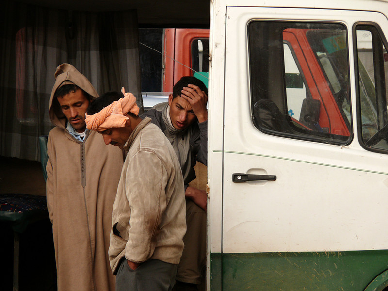 Worries, Tineghir - These men appeared to be the drivers of trucks parked in Tinehir's central square. Apparently, their day could have been a better one.
