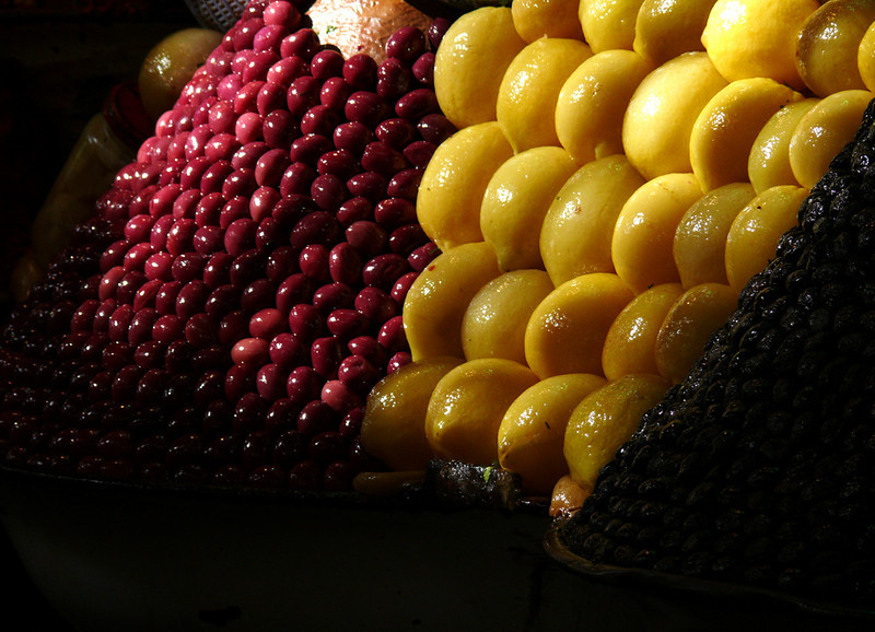 Olives and lemons, Meknes market - Olives and lemons are part of almost every meal in Morocco. Here, they provide striking contrast in size and color in the Meknes market.