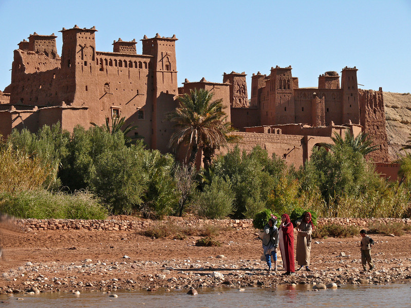 Under the ramparts of Ait Benhaddou - Ait Benhaddou is a ksar, or fortified city. It is now protected as a UNESCO World Heritage site. Toda Ait Benhaddou is a virtual ghost town. Only ten families still live here. The site has been used for background shots in exotic films, including Lawrence of Arabia, Gladiator, and The Man Who Would Be King.