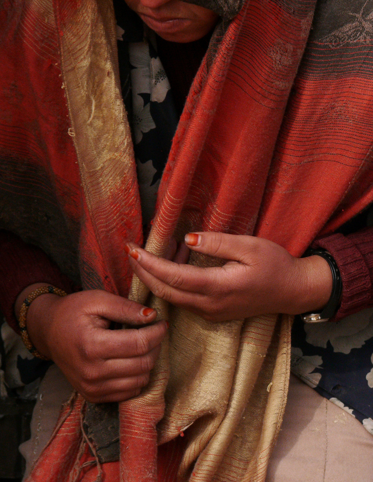 Nomadic hands, Sahara Desert - The hands of the woman seen in the preceding image and this one have known a hard life. Yet there is much grace and beauty in how she uses them.