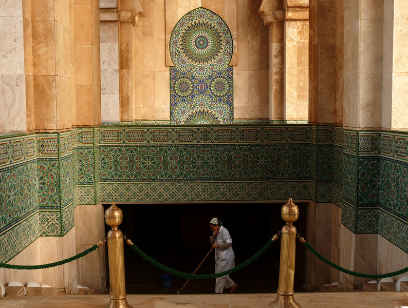 Morning, Mosque of Hassan II, Casablanca - This elegant mosque is Casablanca's main tourist attraction. It is constantly being cleaned, and holds 25,000 worshippers. Opened in 1993, it is the second largest religious building in the world. Only the mosque in Mecca is larger.