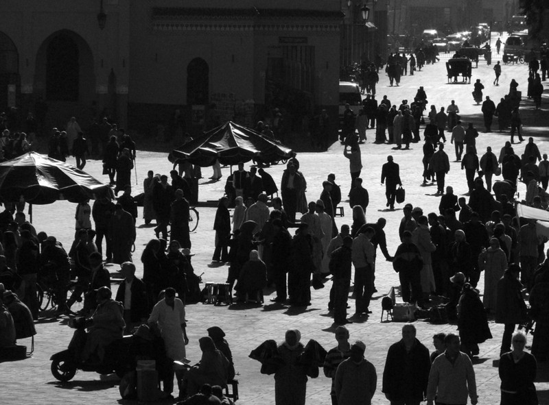 Place Jemaa el-Fna, Marrakesh - For centuries, this square has been the nerve center of Marrakesh and the symbol of the city. It has hardly changed. I made this photograph from the terrace of a restaurant overlooking the square, and converted it to black and white to stress the timelessness of the scene. Thousands of shoppers visit its markets, stalls, wagons, and shops by day. Outdoor restaurants are set up each evening, and the square echoes to the sound of music and drums and the smell of grilled meat.
