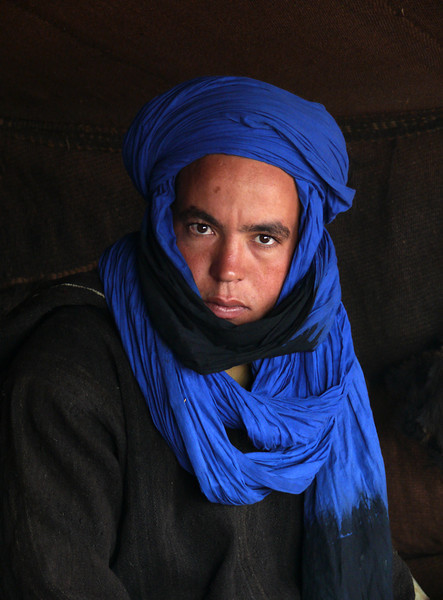 The Blue Man, Sahara Desert - The Blue Men of the Sahara originated in Timbuktu. Berber Taureg's, they wear distinctive blue scarves on their heads. This man lives a nomadic life in the Sahara.