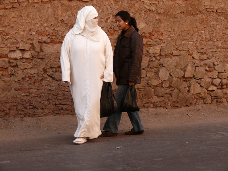 Woman in white, Marrakesh - I did not see many women wearing the characteristic white haik in Marrakesh. It is more often seen in places such as Essaouira. Both of these women carry plastic sacks, a sure sign that they have been shopping.