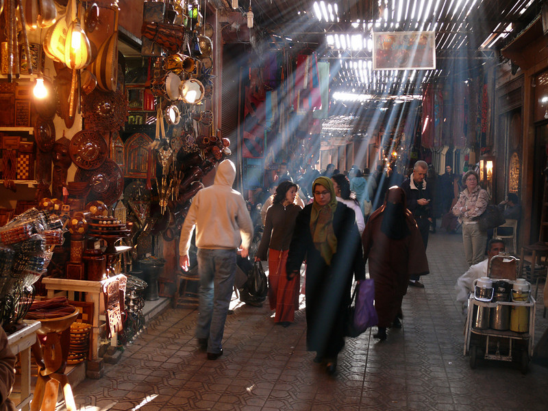 In the heart of the souk, Marrakesh - Originally located on the Saharan trade routes, Marrakesh was a convenient staging post for caravans and developed into a major craft and trading center. Today, its souks carry on the trading tradition. The medina is an intricate maze of narrow streets, often protected from the sun by slated awnings. By mid morning, the Souk Smarine, the busiest street in the souks, is ablaze in shafts of light.