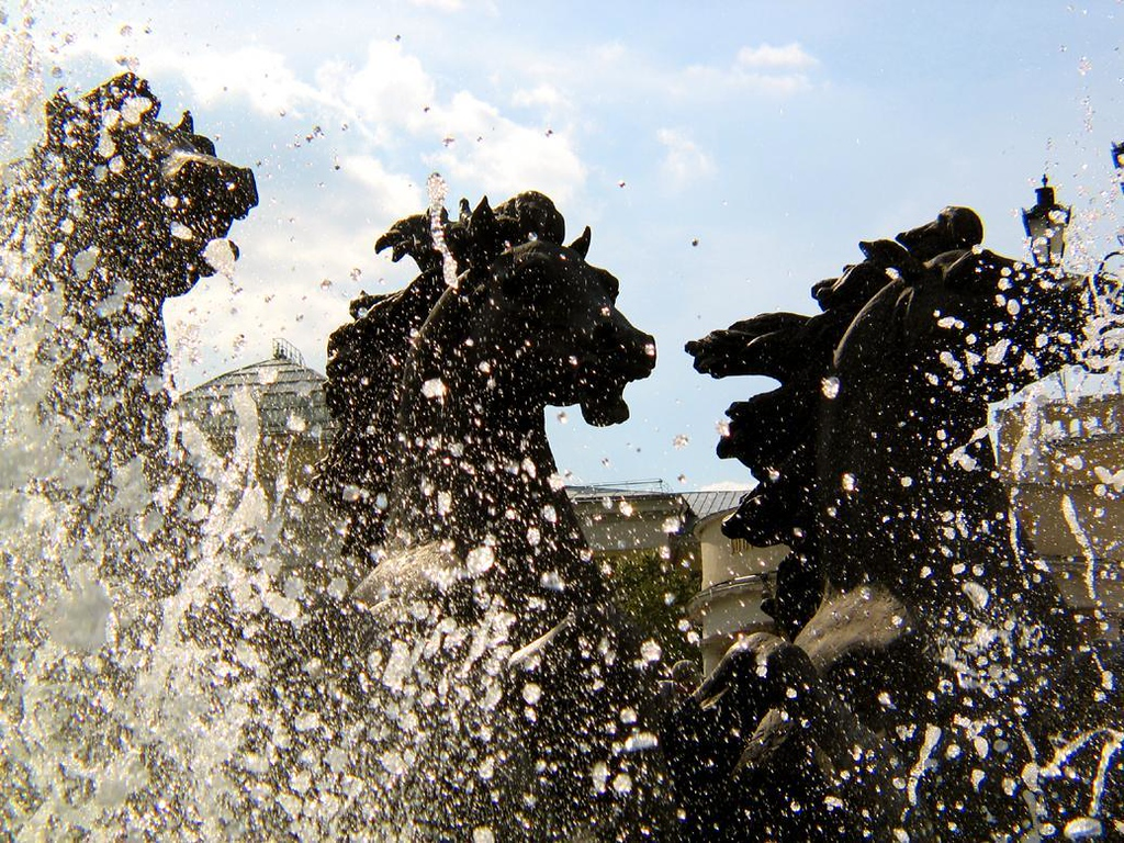 Steeds and spray - A trio of enormous horses gallop through the fountains of Central Moscow.