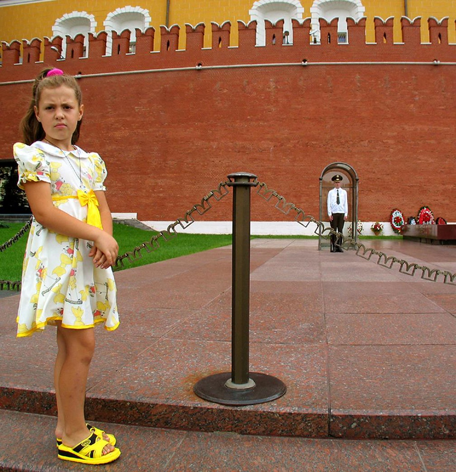 The Mysteries of War - A young visitor at the memorial to Russia's war dead in the shadow of the Kremlin's ancient wall.