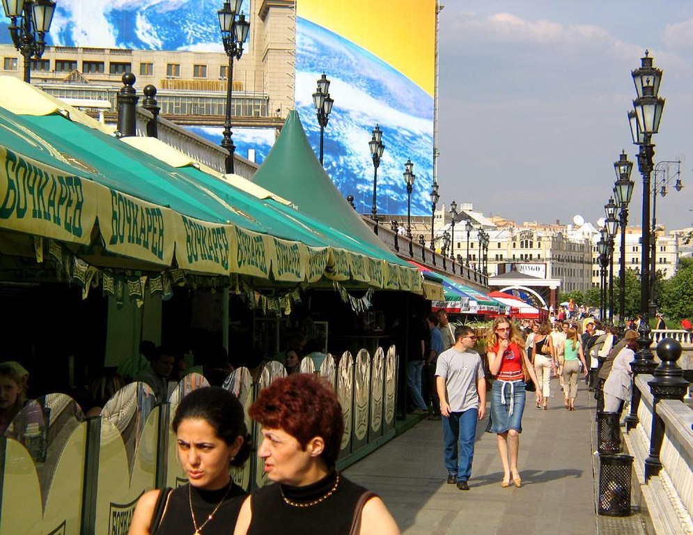 Promenade, Moscow - A long promenade flanking a park near Moscow's Kremlin draws hundreds to its oudoor cafes on a summer afternoon.