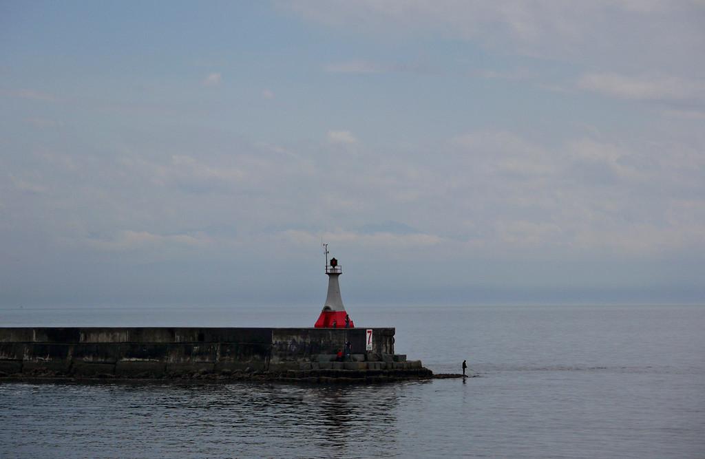 Fisherman, Victoria harbor light, British Columbia