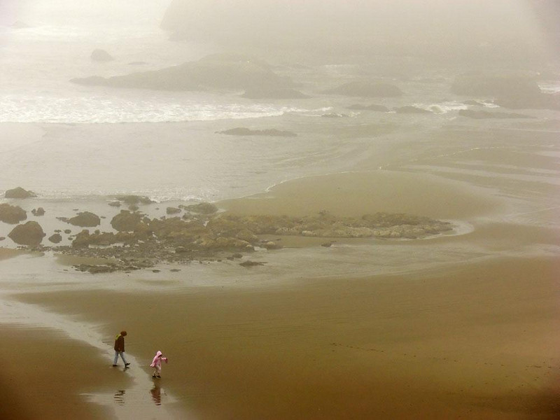 Morning fog, Bandon Beach - A mother and her daughter walk the fog laden beach at Bandon.