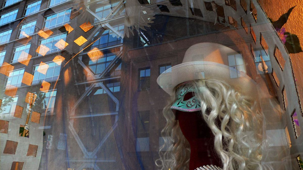 Reflected fantasies - I've blended the reality of urban life with the fantasies displayed in a window of a Portland costume and wig shop.