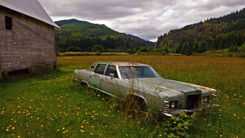 Maude's car, Remote - The most poignant sight in Remote was the abandoned car of Remote's last postmaster, Maude Jennings, who died in 1993. Her Lincoln Continental still stands parked behind the old barn.