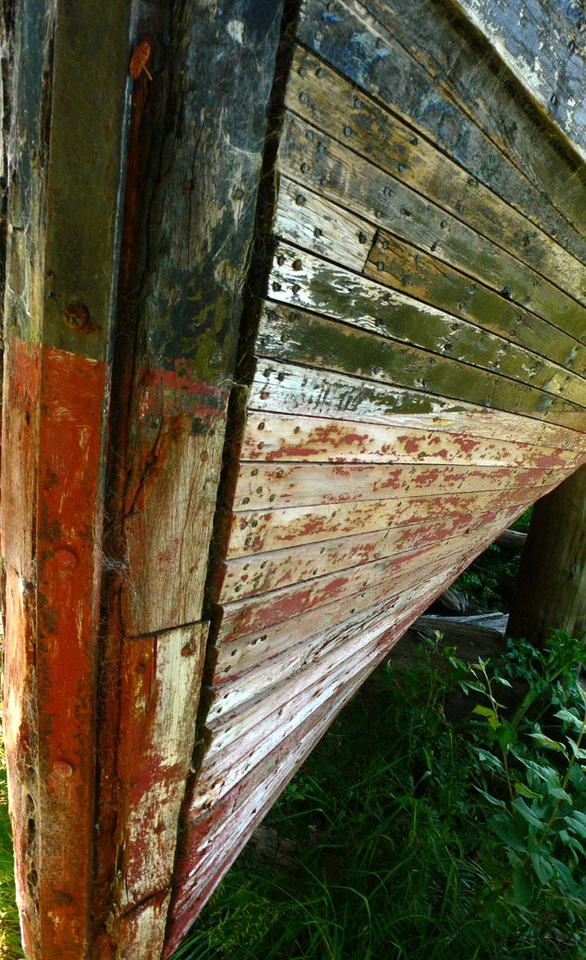 Fishing boat graveyard, Florence - This boat, which once trolled for fish off Florence, now sails on a sea of grass as it slowly disintegrates.