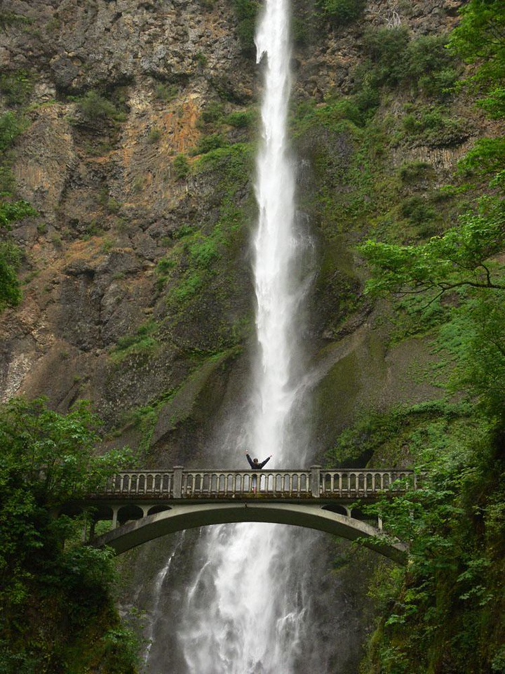 Salute - Multnomah Falls, just outside Portland in the Columbia River Gorge, plunges 611 feet, making it the most visited site in Oregon. A young woman viewing the falls from Benson Bridge spontaneously strikes a joyful pose for the many photographers gathered below. She made my day.