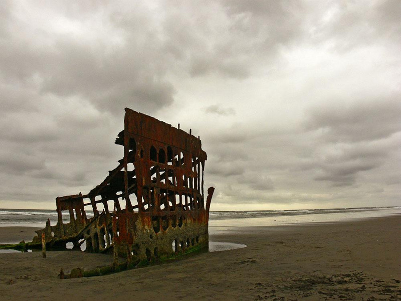 The Wreck of the Peter Iredale - On October 25, 1906, this 276 foot long sailing ship was driven ashore and wrecked by a storm near Tillamook Rock Light. One hundred years later, I made this image of her. Only the corroded steel hull is left -- I was fortunate to visit the beach at low tide so I could photograph this much of it. It has become a major tourist attraction on the Oregon coast.