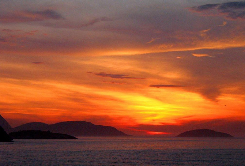Golden landfall in South America - As we drew near Rio de Janeiro harbor at dawn, we were greeted with as beautiful a morning sky as I've ever seen. The sun splashed clouds that hovered over Rio's offshore islands offered us a glorious welcome.