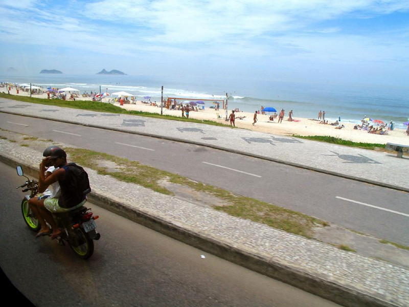 Holiday in Rio - A pair of Cariocas celebrate Christmas Eve in Rio with a fast ride along one of its many beachfront roads.