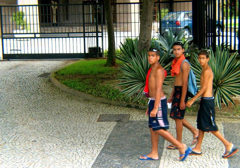 Beachbound Cariocas - Three young Cariocas, as Rio's residents call themselves, head towards a swim at Copacabana beach on Christmas eve.
