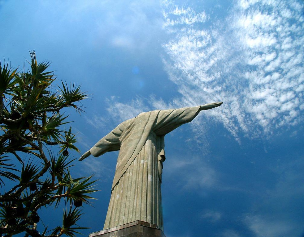 Reaching for the clouds - Corcovado, Rio's highest mountain at 2,330 feet, is topped by a statue of Christ that can be seen virtually everywhere in the city and far out to sea as well. Its hand seems to reach for the clouds that flow above it.