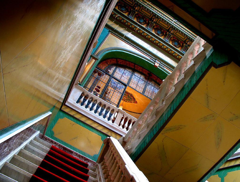 Victorian dreams, Florianopolis - Looking up the stairwell of the Governor's Palace in Florianopolis is a eye-jarring experience. A long dead architect transplanted high Victorian style to the Brazilian tropics. When walking up these stairs, I kept my eyes firmly on the red carpet. Looking up makes the head swim.