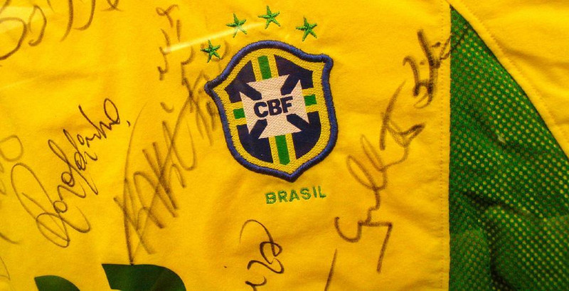 Soccer Champions of the World - Perhaps the most unifying force in Brazil is its passion for soccer, and its pride in its current World Cup Champions. I made this closeup photograph of a framed and autographed Brazilion national team soccer jersey in a well-known Rio barbeque restaurant.