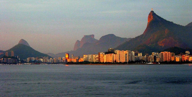 Rio greets the sun - A golden shoreline curves around an azure ocean as Corcovado, topped by a sun splashed statue of Christ, towers over the city's streets. Such was the breathaking scene that greeted the Marco Polo's arrival at Rio de Janeiro.
