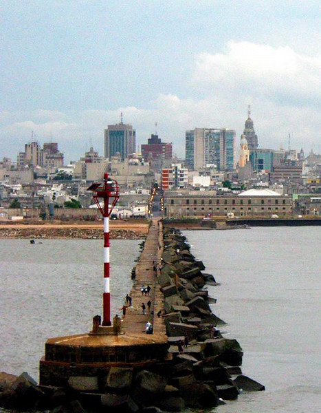 Montevideo harbor - We move past the long breakwater guarding Montevideo's harbor. It leads directly to a street running into the heart of the city.