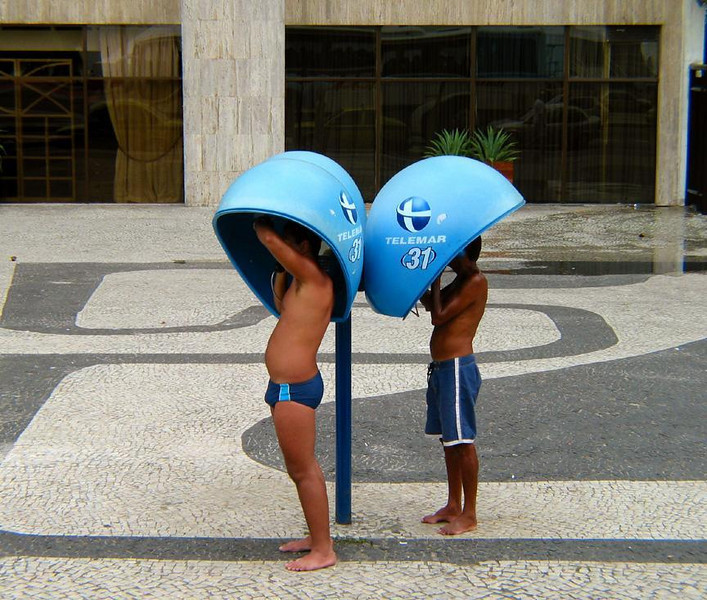 Public phones near Copacabana beach - In Rio, phone booths become phone domes, making conversations easier to hear.