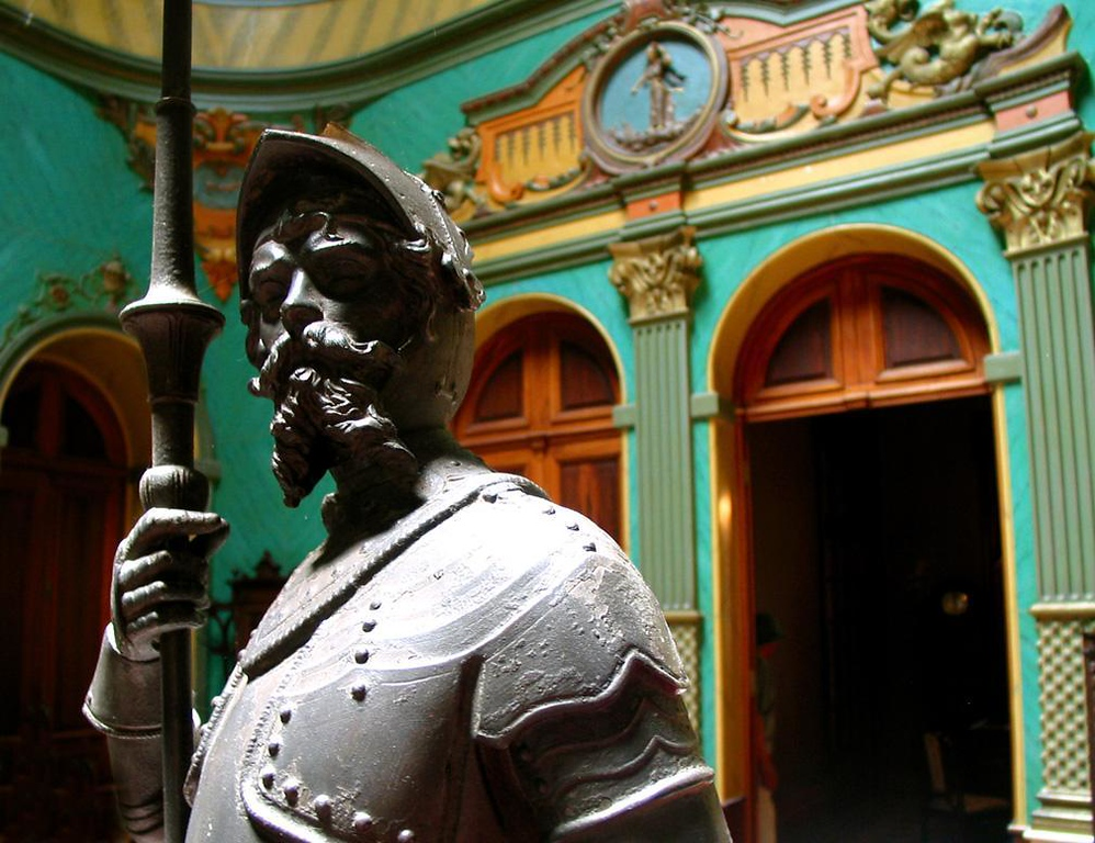 Knight in armor, Florianopolis - Guarding the entrance to the second floor of the Governor's Palace in Florianopolis, a bearded knight in armor stands at the ready. Behind him are lavishly decorated doorways to the Governor's chambers.
