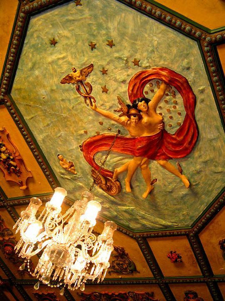 Mercury triumphant, Florianopolis - Perhaps the strangest sight in the Florianopolis Governor's Palace is the three dimensional artwork on the ceiling of its entry hall. The winged-foot God Mercury triumphantly carries off a naked woman who seems to be waving a long red drape as a distress signal. I don't grasp the meaning of this piece, but it surely catches the eye. A fitting close to our tour of what surely is one of most odd, as well as interesting, old palaces in Latin America.
