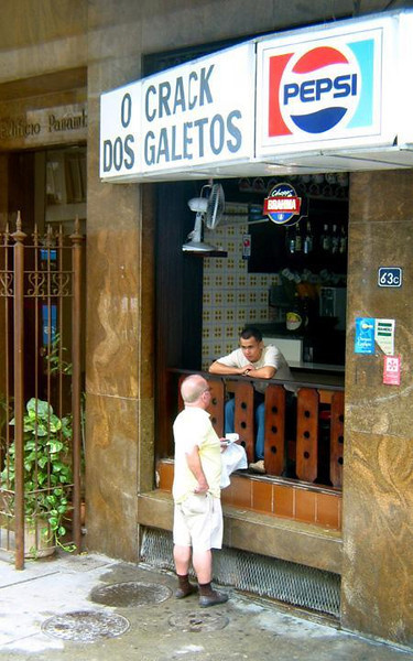 Snack time - Cariocas enjoy a relaxed life style. Snack shops such as this one line Rio's side streets.