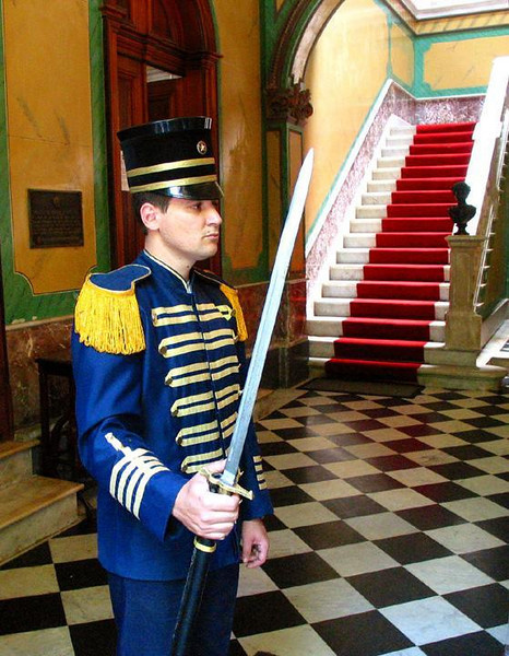 Sentry, Governor's Palace - In the entrance hall of Santa Catarina's Governor's Palace in Florianopolis, a sentry still stands guard at all times. He holds a 19th Century bayonet that is as long as a sword.