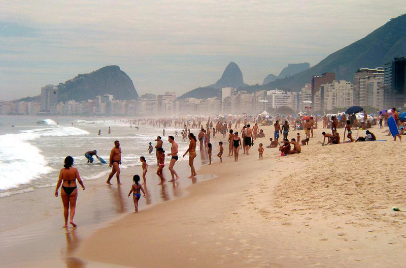 Christmas eve, Copacabana Beach - Thousands crowd the sands of Rio's most famous beach on a warm but cloudy Christmas eve.