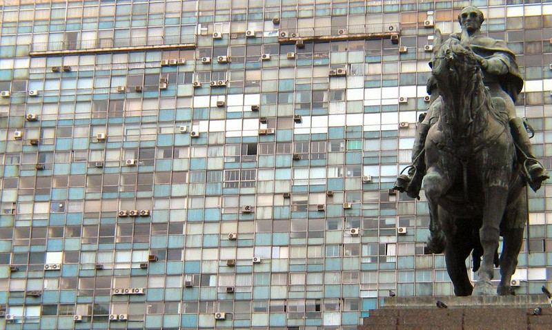 Montevideo, then and now - The great equestrian statue of General Artigas rides before a massive apartment complex bordering Independence Square in Montevideo. Artigas is entombed just behind the statue.
