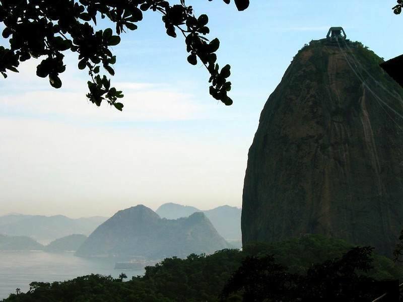 Sugar Loaf looms large over Rio - While only half as high as its rival, Corcovado, Sugar Loaf is one of Rio's major tourist attractions, and its distinctive shape is a familiar landmark. It is really two mountains in one.