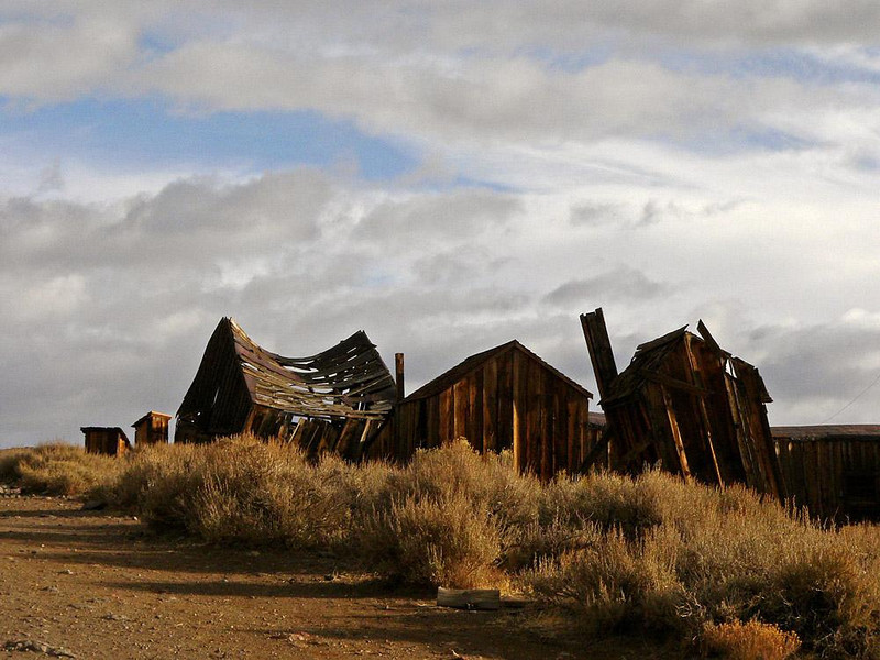 Bodie Skyline - Many of Bodies structures lie open to the elements, such as this group of crumbling buildings in the middle of town.