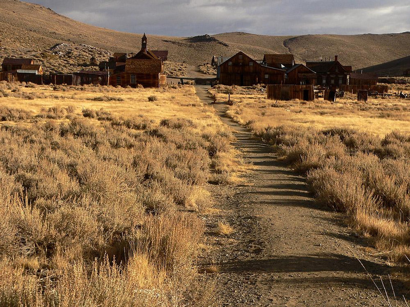 "Bodie, The Last Great Ghost Town - Bodie, a genuine California gold-mining ghost town a few miles from the Nevada border, was once a booming, brawling, blasphemous town of 10,000, ""a sea of sin, lashed by the tempests of lust and passion."" Between 1860 and 1938, its rugged miners pulled $100 million worth of gold and silver from the ground. Today, that same ground is slowly reclaiming Bodie. Only five per cent of its buildings still remain. It is now a place suspended in time, a state historic park preserved in a state of arrested decay."