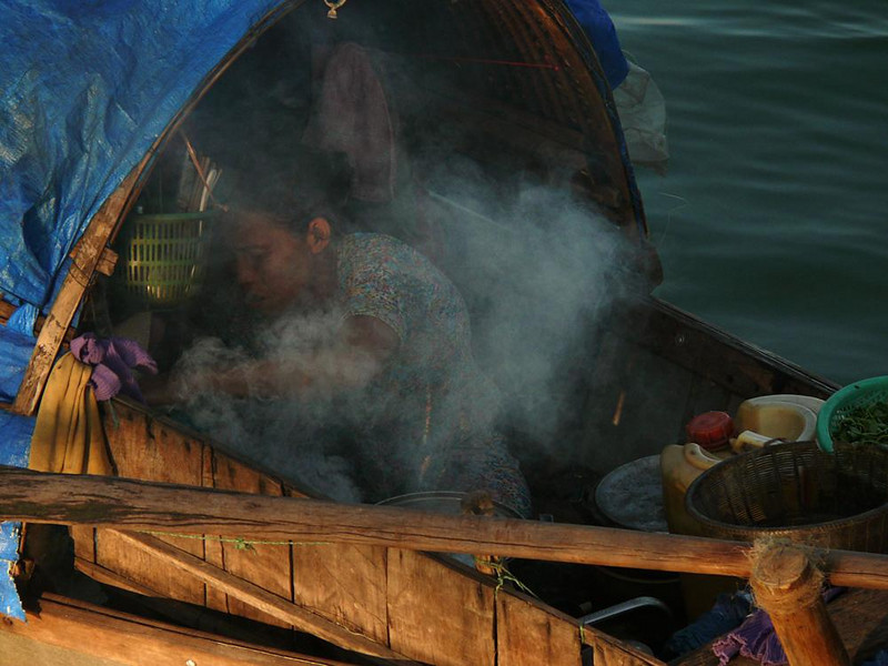 Cooking on the Perfume, Hue - The Perfume River is lined with small houseboats in downtown Hue. I made this photograph from a bridge around dinner time.
