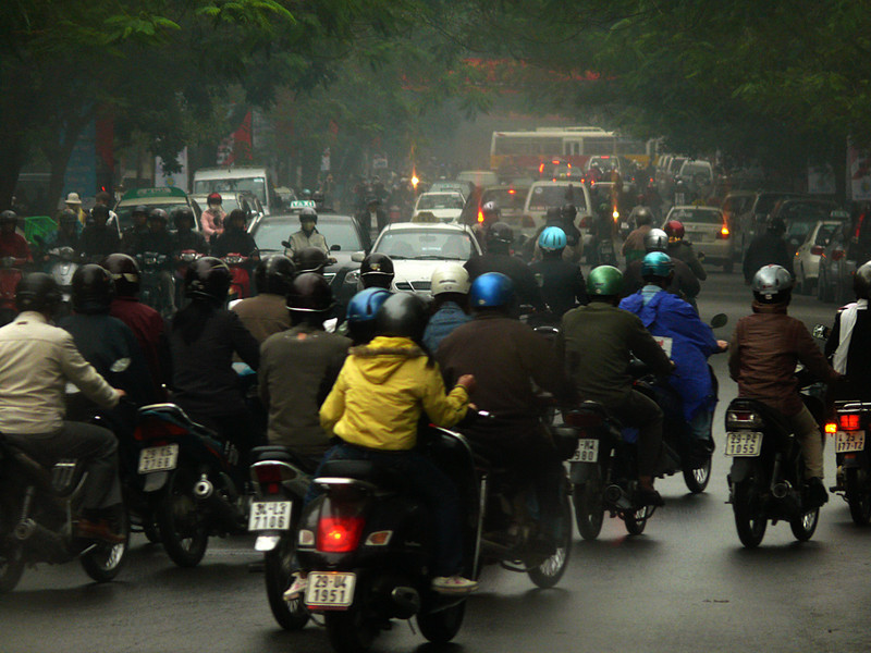 Hanoi traffic - The streets of Vietnam's capital are flooded with motorbikes of all kinds. As of 2007, all drivers must wear helmets.